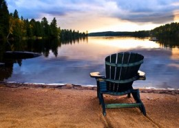 6243695 - wooden chair on beach of relaxing lake at sunset