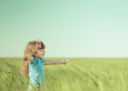 38104089 - happy child in spring field. young girl relax outdoors. freedom concept